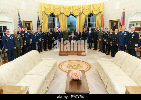 U.S President Donald Trump poses for a photo with senior military commanders in the Oval Office of the White House October 23, 2018 in Washington, DC. - Stock Image