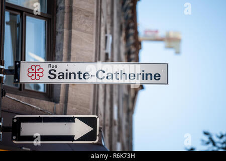 MONTREAL, CANADA - NOVEMBER 4, 2018: Street sign indicating Rue Sainte Catherine Street in Montreal, Quebec. Located in tdowntown, it is one of the mo - Stock Image