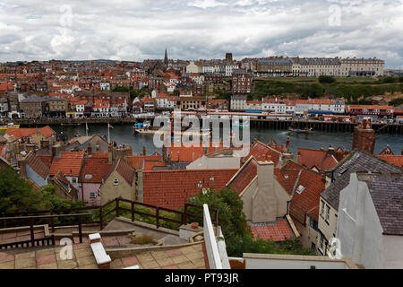Whitby Harbour, viewed from the steps leading up to Whitby Abbey - Stock Image
