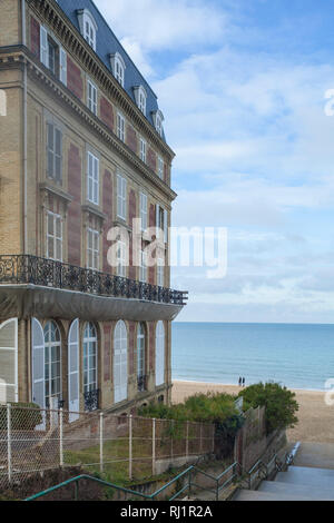 Looking out over the Seine to Le Havre by the Résidence Les Roches Noires, Trouville, Normandy, formerly Hôtel des Roches Noires. - Stock Image