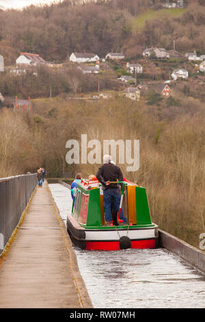 Man steering a narrow boat over the Pontcysyllte Aqueduct on the Llangollen canal  in North Wales above the river Dee built by Thomas Telford 1805 - Stock Image