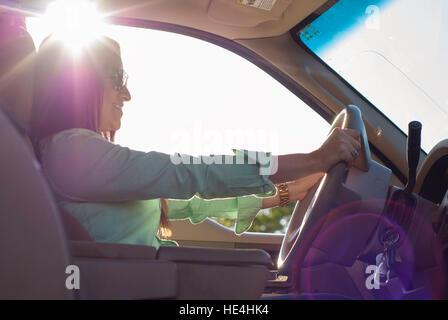 Hispanic Young Woman Driving Car - Stock Image
