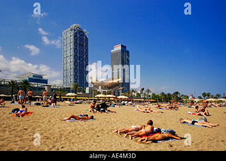 Spain Barcelona beach Platja de la Barceloneta people Hotel Arts former Olympic village - Stock Image