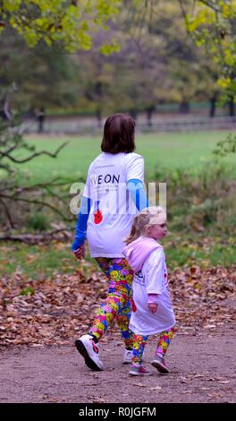 Mother and Daughter running,The Royal British Legion Poppy Run on Wollaton Park,Nottingham,England,UK. Credit: ACORN 1/Alamy Live News. - Stock Image