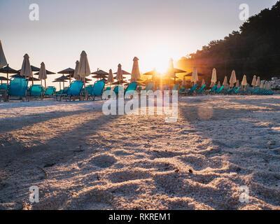 Sunrise light at Porto Vathy beach in Greece. Lens flare effect visibile. - Stock Image