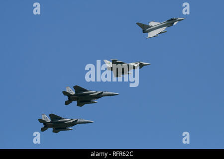 A mixed formation of RAF Typhoon FGR4s and USAF F-15C's recover back to RAF Coningsby during a combined exercise by the 493rd FS, USAF and 11 Sqn, RAF. - Stock Image