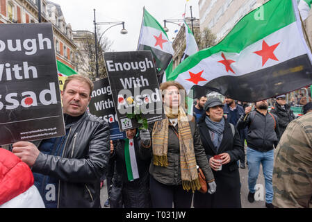 London, UK. 16th March 2019. Syrians march through London from Paddington to a rally in Whitehall on the 8th anniversary of the start of the Syrian revolution to say NO to Assad, NO to extremists, NO to forced displacement, NO to war crimes and NO to foreign occupation. They want a peaceful, democratic Syria. Peter Marshall/Alamy Live News - Stock Image