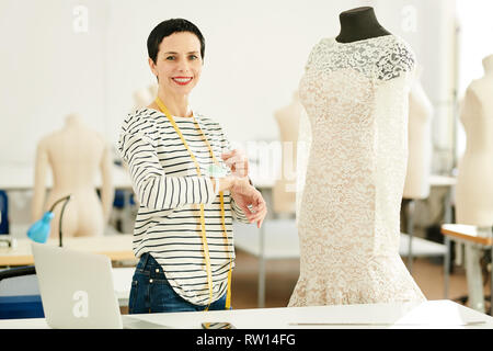 Tailor at work - Stock Image