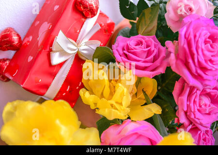 life event, red present and birthday flowers - Stock Image