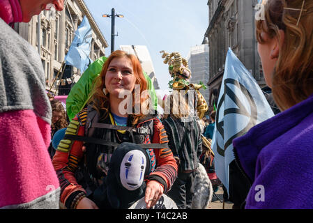London, UK. 15th April 2019. Extinction Rebellion environmental campaigners close Oxford Circus to traffic and create a sea of protest around a large pink yacht, names after the Honduran environmental activist and indigenous leader, Berta Cáceres, assassinated for her activism in 2016. XR intend to keep the roads closed until the government takes necessary action on the global climate and ecological emergency. Credit: Peter Marshall/Alamy Live News - Stock Image