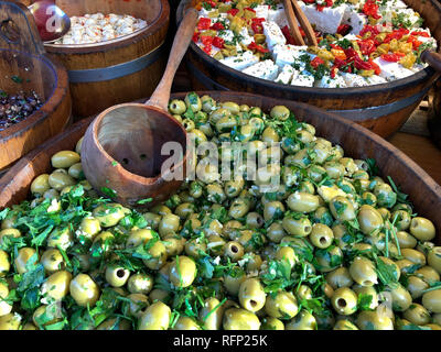 Big tub of olives on a market stall. Portobello Road in London, England. - Stock Image