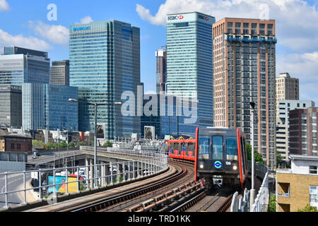 Tower Hamlets Canary Wharf Barclays Bank & HSBC banks building development on skyline East London Docklands DLR passenger train transport England UK - Stock Image