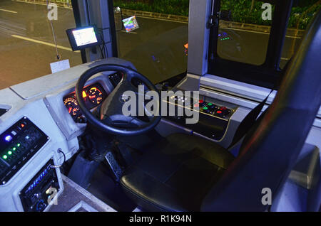 Driver's seat of Royal Trans bus - Stock Image