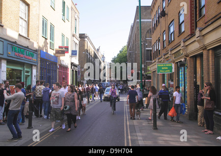View along Brick Lane in London's East End - Stock Image