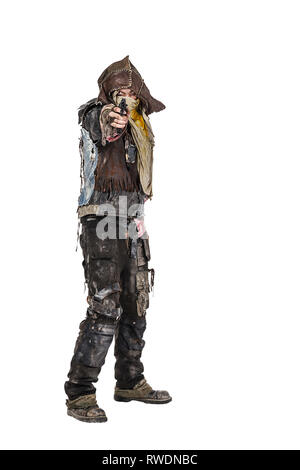 Grimy post apocalypse survivor pointing a gun at the camera. - Stock Image