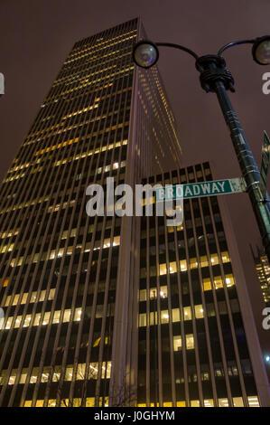 Skyscraper on Broadway New York City (NYC), Street Sign, Night - Stock Image