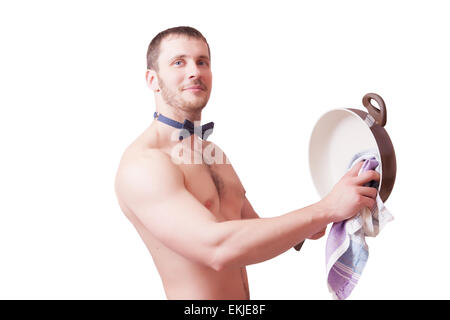 Attractive man with a towel wipes clean pan, isolated - Stock Image