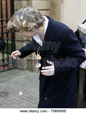 File photo dated 6/2/2006 of the then Education Secretary Ruth Kelly being hit by an egg outside Salford Magistrates Court. Nigel Farage was hit with a milkshake in Newcastle city centre during a Brexit Party walkabout ahead of this week's European elections. - Stock Image