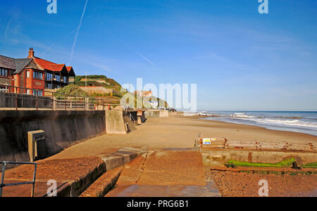 A view from the east end along the beach at the North Norfolk village resort of Mundesley, Norfolk, England, United Kingdom, Europe. - Stock Image