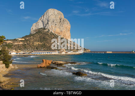 Calpe Spain Penon de Ifach landmark rock Spanish Mediterranean coast with blue sky and waves - Stock Image