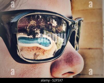 Reflective shades, summer - Stock Image