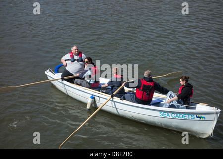 Sea Cadets rowing a boat in Milford Haven. - Stock Image