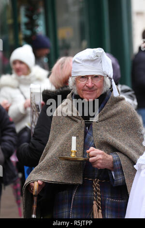 Rochester, Kent, UK. 1st December 2018: A parade participant in Dickension era custume takes part in the main parade. Hundreds of people attended the Dickensian Festival in Rochester on 1 December 2018. The festival's main parade has participants in Victorian period costume from the Dickensian age. The town and area was the setting of many of Charles Dickens novels and is the setting to two annual festivals in his honor. Photos: David Mbiyu/ Alamy Live News - Stock Image