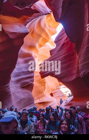 Tourists inside Lower Antelope Canyon in Arizona. - Stock Image