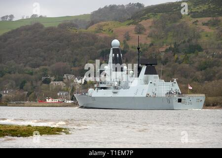 River Clyde, Erskine, UK. 26th Mar, 2019. UK, Europe. HMS Defender says goodbye again as it passes under the Erskine Bridge on its way to open water after its short stay and weekend public open day in Braehead, Glasgow. Defender is now heading out to sea for Exercise Joint Warrior, a multinational military exercise off the Scottish coast. Credit: Douglas Carr/Alamy Live News - Stock Image