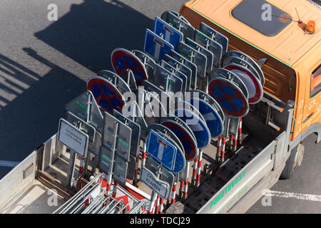 A lot of road signs on the truck - top view - Stock Image