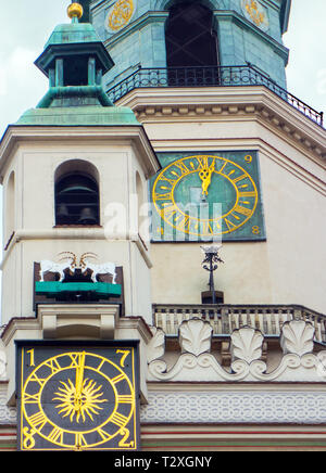 The clock and clock tower on the town hall in the old market place in the Polish city of Poznan Poland with its fighting butting goats - Stock Image