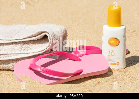 Bournemouth, UK. 26th June 2018. UK Weather, a heatwave in June. Sandy beach in Bournemouth with sun cream at the ready. Credit: Thomas Faull / Alamy Live News - Stock Image