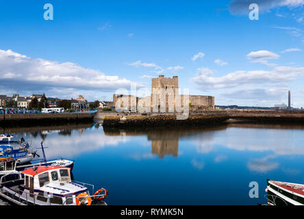 Carrickfergus castle and Harbour at the mouth of Belfast Lough - Stock Image