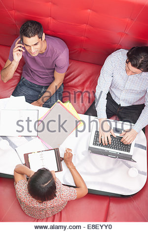 Smiling businessman talking on cell phone in meeting - Stock Image