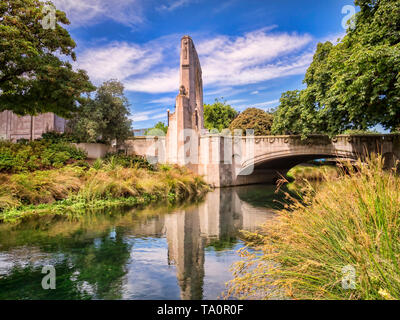 The Bridge of Remembrance and Cashel Street Bridge in the centre of Christchurch, New Zealand, reflected in the River Avon. - Stock Image
