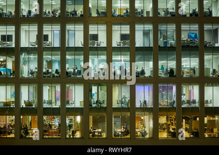 KPMG 1 Saint Peter's Square, Manchester city centre Modern office development windows looking into the open plan office - Stock Image