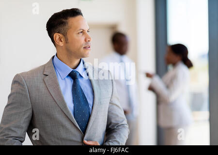 thoughtful business man inside an office building - Stock Image