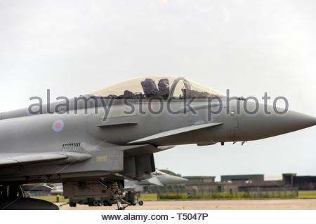 Eurofighter Typhoon pilot waving from his cockpit while taxiing - Stock Image