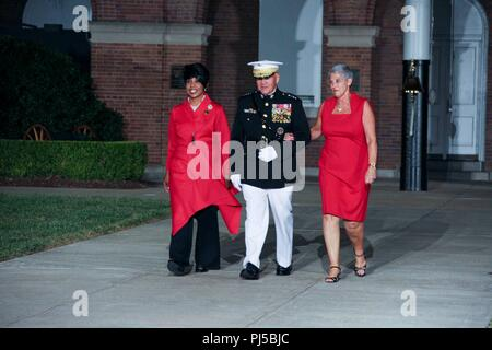 From left, Dr. Betty Moseley Brown, President of the Women Marines Association, Commandant of the Marine Corps Gen. Robert B. Neller, and D'Arcy Neller, walk down Center Walk during an evening parade at Marine Barracks Washington, Washington D.C., Aug. 31, 2018. Gen. Neller hosted the parade and the guest of honor was Dr. Betty Moseley Brown.(U.S. Marine Corps photo by Sgt. Olivia G. Ortiz) - Stock Image
