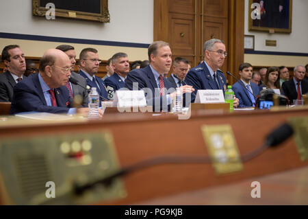 Secretary of Commerce Wilbur Ross, left, NASA Administrator Jim Bridenstine, center, and Commander, U.S. Strategic Command, General John Hyten testify before the House Subcommittee on Strategic Forces during a hearing on Space Situational Awareness: Whole of Government Perspectives on Roles and Responsibilities, Friday, June 22, 2018 at the Rayburn House Office Building in Washington. - Stock Image