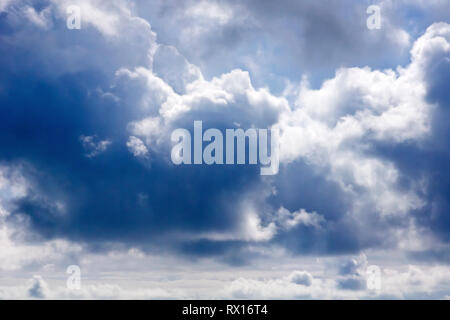 Rain clouds (cumulo nimbus) start to build on a nice spring day. - Stock Image