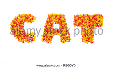 writing text cat made from yellow red dry cat food isolated white background - Stock Image