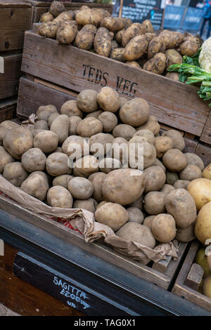 Borough Market rustic attractive home grown vegetable stall. British home grown 'Chemical Free' farm produce, Sagitta Potatoes on display at  'Teds Veg' stall Borough Market Southwark London UK - Stock Image