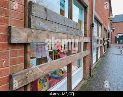 Ashbourne, UK. 11th February, 2018. All boarded up. Ashbourne town centre shop windows are boarded up for the start - Stock Image
