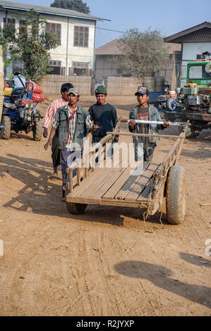 Men with a cart at the marketplace Heho,  Kalaw Township, Taunggyi District, Shan State of Myanmar - Stock Image