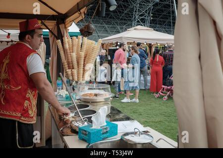 February 22, 2019 - Abu Dhabi, UAE: Turkish Ice cream cones and Ice cream maker - Stock Image