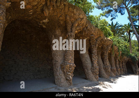 Stoney arches and building designed by Antoni Gaudi at the Park Guell, Barcelona, Spain - Stock Image