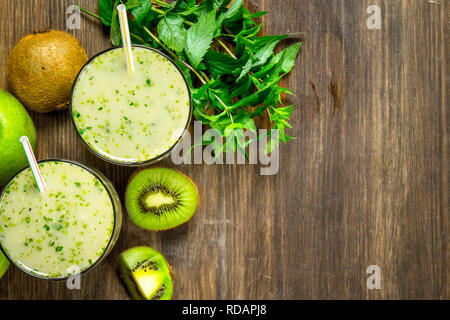 Green smoothie with kiwi and mint. On a wooden background. - Stock Image