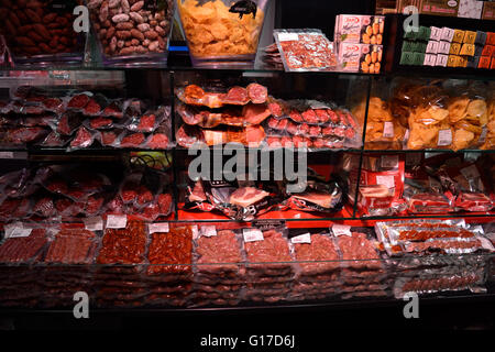 Spanish charcuterie in a London shop. An assortment of colourful sausages and other meats in a Soho tapas bar, one - Stock Image