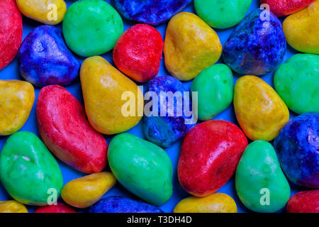 Many colored stones blue green red and yellow. - Stock Image